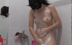 A girl with a sexy butt takes a shower and plays with water and fucks with a sex toy