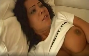 Busty brunette babe rides a big cock and gets facialized
